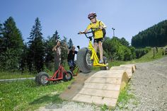 The Zau[:ber:]g Semmering Bike Park is about ten kilometers long and consists of a downhill run, two  freeride runs and a family run. There is something for every ability level. Bike Park novices, families and  groups can also have a ball taking monster scooters down the family run. Location Scout, Bike Parking, Outdoor Power Equipment, Bicycle, Sports, Scooters, Highlights, Renting, Waves