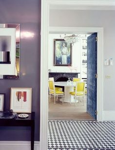 great details:  the pattern on the floor, nail head trimmed door & great combo of colors yellow, deep lilac, pale lilac, a dusky dark blue, & black 'n white