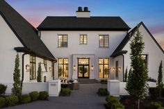 Beautiful Modern Farmhouse Exterior With Cypresses And Boxwoods