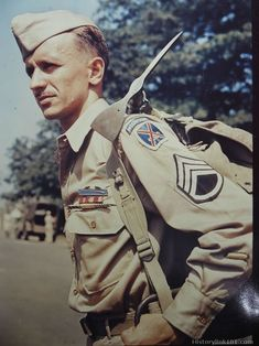 d919ef555 Ice axe hooked through the shoulder straps of his musette bag is a typical  trooper of the Mountain Division. His decorations include th.