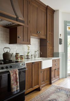 A cornerstone of the Capitol Hill House renovation was transforming an early 1900s kitchen into a space with modern functionality that remained authentic to the late 19th century architectural style.  The kitchen island is a hefty antique butcher block and the oak cabinets from The Kennebec Company are a highlight that the owners first spotted at a home..