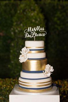 Navy & gold cake | SouthBound Bride | http://www.southboundbride.com/glamorous-navy-pink-gold-wedding-frances-kobus | Credit: Marsel Roothman