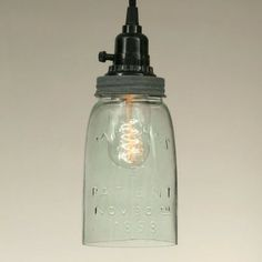 Quart Open Bottom Mason Jar Swag Pendant Lamp - Barn Roof has a ventilated lid and no bottom. Use these lamps for higher wattage bulbs such as 40 or 60 watts. Shown with a vintage 40-watt bulb. Light bulbs are not included. This swag pendant includes it all: 15½ foot cloth-covered lamp cord with switched socket, two finished ceiling hooks, two cord clamps for adjusting the height of the lamp, and easy-to-follow instructions. This lamp plugs into any wall outlet; no wiring required.