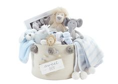 "This basket from Mud Pie showcases all things ""boy"" and displays the more neutral color trends, with a hint of blue. Baby Trends Article - Gift Shop Magazine"