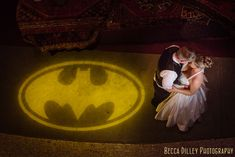 Batman gobo on floor! Such an unexpected way to bring a lot of fun into a space! Minneapolis Varsity Theater Wedding with Batman Light {Andrea + Justin}
