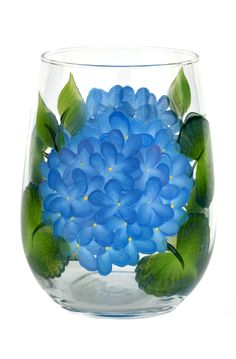 Bright blue hydrangeas hand-painted encircling a quality 17 oz stemless wine glass. Sealed and heat-cured for added durability. Top-rack dishwasher safe; hand-washing preferred.