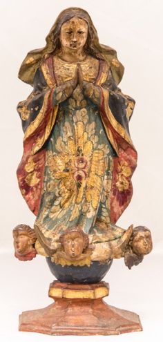 Imagem de madeira policromada, Nossa Senhora da Conceição. Bahia, século XIX. Alt. 30cm. Vendida 700,00.