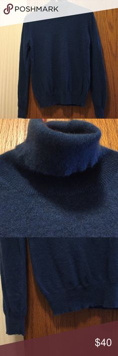 """Sutton Studio Cashmere Sweater From Bloomingdales. Excellent condition. 100% cashmere. Thick and soft. Long sleeve turtleneck. Dark blue. Banded sleeves and bottom edge. Not from a smoke free house. Dry clean or hand wash only. 17"""" armpit to armpit. 14"""" long from armpit. Sutton Studio (Bloomingdales) Sweaters Cowl & Turtlenecks"""