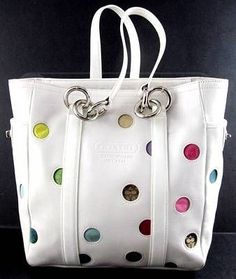 COACH Too cute perfect for spring . This would match with anything in my wardrobe.