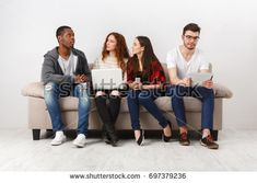 Multiethnic young students study with gadgets, preparing for exam, sitting on sofa in living room, studio shot Student Studying, Studio Shoot, Gadgets, Students, Sofa, Living Room, Fashion, Moda, Settee