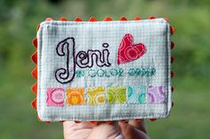 Jeni of In Color Order. I love how she used embroidery to get the font of her name just right! Of course it includes a rainbow!