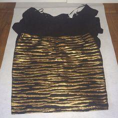 Forever 21 animal print skirt Forever 21 black and gold animal print body con skirt. Forever 21 Skirts Mini