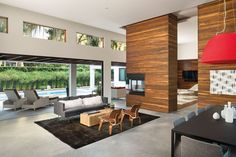 Cool family-to-living room transition with fireplace. The tile floors are warmed up by the wood too.