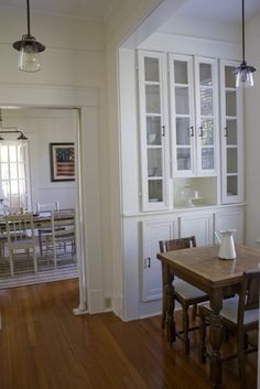 """""""The 8′ dining room table was built by Ben from old deck boards and my parents' old front porch columns."""""""