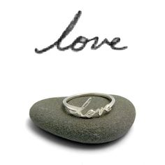 """A sweet, little custom handwriting ring in sterling silver. A small but special way to remember a loved one through their writing.  DETAILS  • Sterling silver • Writing will vary in size, but an average word is about .15 - .25 high by .5 - .675 long and is always .05"""" (1.3 mm) thick. • Simple ring band with squared edges • Only available for words of 8 letters or less…"""