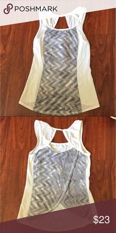 Lululemon Tank White and gray striped Lulu tank, size 4. Worn a few times but still in great condition. lululemon athletica Tops Tank Tops