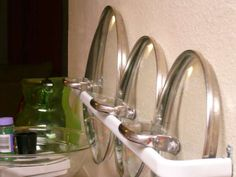 Use towel racks on the inside of cabinet doors to hold your pot lids. #towelholders #potlids #cabinetorganization cabinets, pot lid, curtains, towel racks, organ, curtain rods, cabinet doors, kitchen, towels