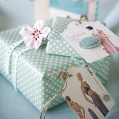 Vintage style gift wrapping can be achieved by using wrapping paper with small prints, vintage style tags and embellishment #giftwrap.#vintage #tag