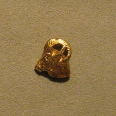 Achaemenid Gold Jewelry: Head of a wild ram 6th-4th century BC  The type of pin Alyssa is given when she has her fortune read at the festival.