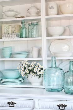 Sea glass aqua in kitchen hutch with old white ironstone - gorgeous!