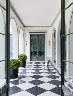 architectural digest We dont see it often these days, but we its coming back into popularity in new ways. Architectural Digest, Exterior Design, Interior And Exterior, Checkered Floors, Bright Rooms, Black And White Marble, My Dream Home, Custom Homes, Future House