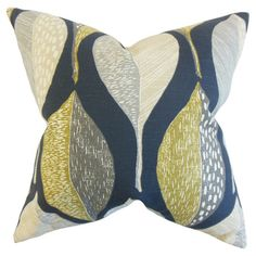 Lend a pop of pattern to your sofa, arm chair, or bedding with this stylish cotton pillow, showcasing a leaf-inspired motif in blue.