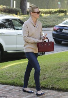 Picky: January, pictured arriving to the Pasadena mansion with red bag in hand, has also looked at homes in the Beverly Hills neighbourhood