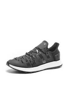 "This Y-3 SPORT trainer is built on a wide, low to the ground platform for a natural body stand. It is designed to blend stability and durability perfectly. The rubber toe wrap and ""Y"" shaped micro traction make it the most ballistic and versatile trainer no matter the surface you encounter."