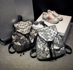 6368c293b32d 2017 New women s backpack Geometric Shoulder Student s school bag Hologram  bag laser silver Luminous Brand bao bao bag backpacks