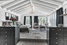 The team were able to deliver a stunning master bedroom, which extended into the existing front garden area, giving the family an additional 32.20m2 of space. An impressive dressing room was added which flowed seamlessly from the bedroom and into the adjoining resort-style bathroom.  #homerenovation #renovation #dreambedroom #bedroominspiration #parentsretreat #rakingceiling #rakedceiling #chandelier
