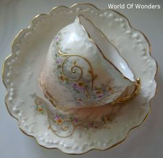 bone china teacup and saucer edged in gold --So dainty and sweet!