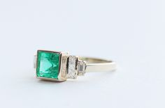 Custom MOCIUN Square Emerald Ring. Square cut emerald, white diamonds set in 14K yellow gold.