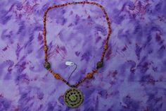 Hand-strung glass seed bead necklace with fun focal point