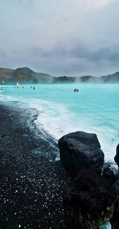 Relax in the warm, mineral-rich waters of the Blue Lagoon outside Reykjavik, Iceland. Definitely on the bucket list!