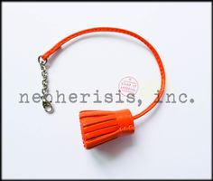 Hermes Carmencita bookmark or bag charm. Color is Feu. Large size. New condition with Hermes box & ribbon.
