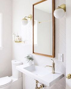 Yep, you nailed it @sarahshermansamuel!!  SO obsessed with gold accents and herringbone tilework in the bathroom. Thanks for sharing your #myoklstyle snap!  ✨Link in profile to shop this look.✨ #regram