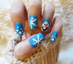 If you fell in love with Olaf, the goofy animated snowman from Frozen, you'll love this holiday nail design.
