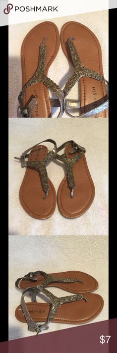 Madden Girl flat sandals. Good used condition, 2nd picture shows a couple of scuffs on the front of shoes. Cute beaded strap! Madden Girl Shoes Sandals