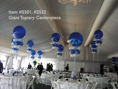 Balloon Centerpieces Topiary. I'm picturing these in different hues of orange/peach/red/pink. Warm colors.