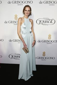 Model Daria Strokous wears a silky pastel blue number at the De Grisogono party