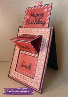 handmade birthday card ... monochromatic old brick red ... sliding east card ... luv how this one stands up with face forward ranther than lying flat with the easel section upright ... easy photo tutorial on the Crafter's Companion blog ...