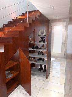 Studio per ottimizzare un sotto scala con un armadio a muro