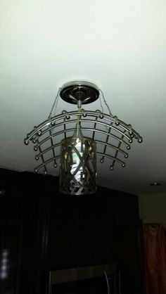 Overhead light made from fruit basket and candle holder