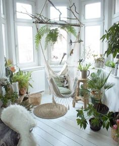 balcony orangery with a crochcted white hammock chair