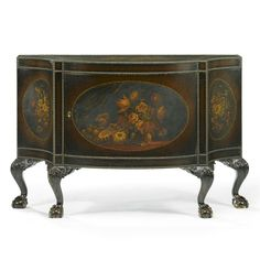 A bow fronted side cabinetin George III style, 20th centurythe top and sides covered in canvas and painted with still lifes of flowers within oval cartouche, the borders trimmed with brass nails, the front with three hinged doors, the inside fitted with adjustable shelves, raised on curved paw-and-ball feet, reddish brown patina