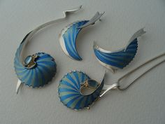 Brian Eburah - Titanium, Silver, Gold & Blue Topaz brooch, earrings and pendant.