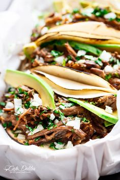 Slow Cooker Barbacoa Short Ribs full of barbacoa flavours! Meat so tender it falls off the bone before being stuffed into Taco's and served with Avocado! | http://cafedelites.com