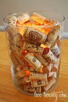 Wine cork centerpiece - find nice shaped glass vases (3 per table) full of Andretti wine corks with red LED lights in the middle