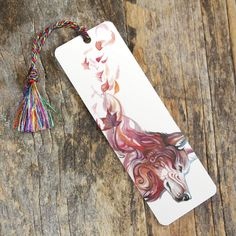 """This bookmark features """"Sanctuary"""".  This bookmark features our newest and highest-quality bookmark style: a rigid, high resolution lamination print with rounded edges.  Measures roughly 2.25x6.25""""  Includes a tassel in a color that compliments the image."""