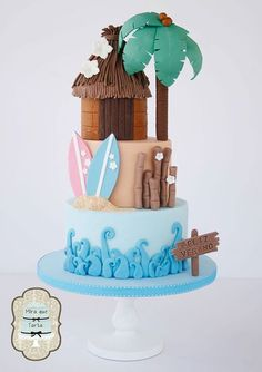 11 Summer cake - Three Tiers = Bottom is blue for water and waves; Middle is tan for sand with surfboards; Top is a brown hut with a Palm Tree. Beach Themed Cakes, Beach Cakes, Theme Cakes, Cake Original, Hawaii Cake, Surf Cake, Luau Cakes, Bolo Cake, Summer Cakes
